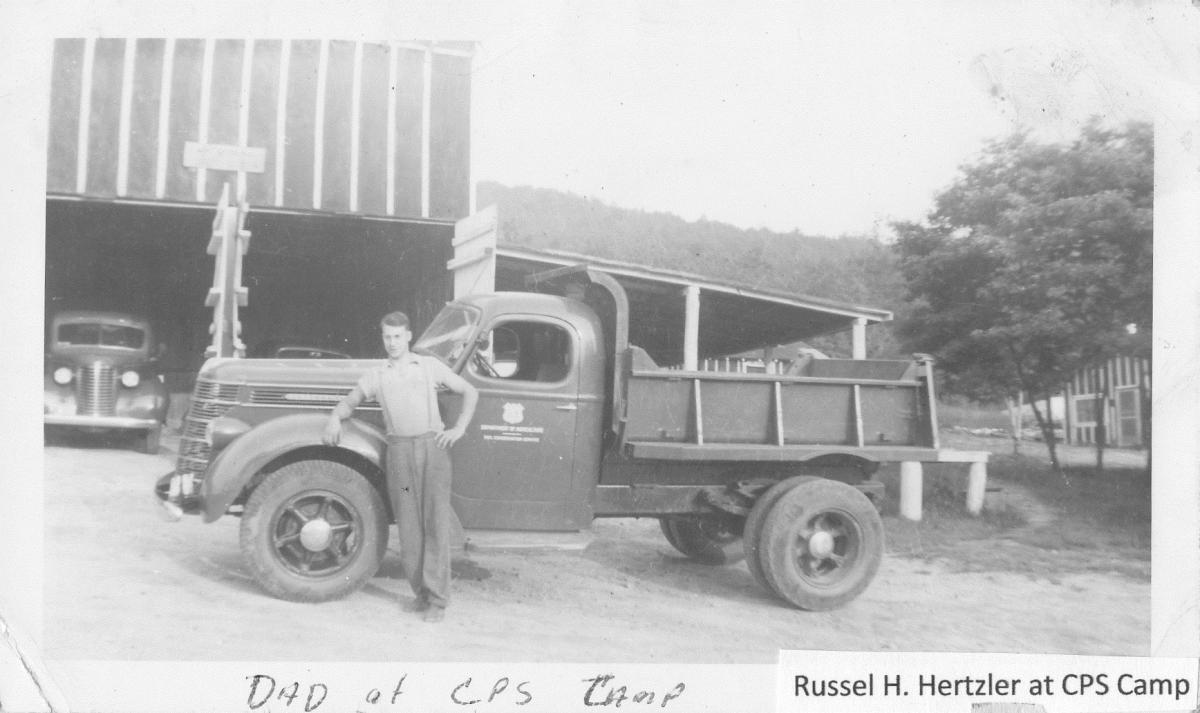 Russell Hertzler with Truck